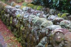 The stone of statues at rain day. The Otagi Nenbutsu ji Temple, Kyoto, Japan Royalty Free Stock Photos