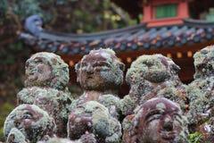 The stone of statues at rain day. The Otagi Nenbutsu ji Temple, Kyoto, Japan Royalty Free Stock Photo