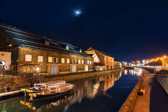 Otaru canal and boat at night Stock Photos