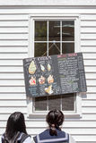 Otaru, Hokkaido, Japan- June 5, 2016. Two Japanese teenagers rea Royalty Free Stock Photography