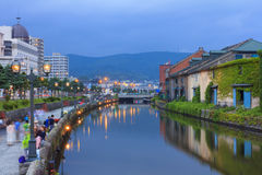 Otaru, Japan historic canal and warehouse, Sapporo, Hokkaido. Otaru, Japan historic canal and warehouse in summer twilight time, people are walking alongside stock images