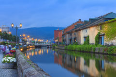 Otaru, Japan historic canal and warehouse, Sapporo, Hokkaido. Otaru, Japan historic canal and warehouse in summer twilight time, people are walking alongside stock photography