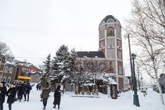 Otaru, Japan, January 28, 2018: The Le Tao Clock Tower with chiming bells is the home of Le Tao, the famous chocolate boutique. And cheesecake specialty store royalty free stock image