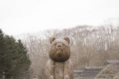 Otaru& x27;s bear statue in color, Sapporo in Japan. There is a bear statue standing alone surrounding by the forest in colors in Otaru, Sapporo in Japan Royalty Free Stock Photography