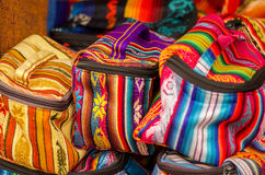 OTAVALO, ECUADOR - MAY 17, 2017: Beautiful andean traditional lunch box textile yarn and woven by hand in wool, colorful Royalty Free Stock Photos