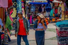 OTAVALO, ECUADOR, NOVEMBER 06, 2018: Outdoor view of hispanic indigenous people in a street market in Otavalo. Ecuador stock images