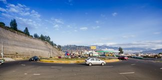 OTAVALO, ECUADOR, SEPTEMBER 03, 2017: View of some cars traveling around the arena in a beautiful day, in a rural road. On the outskirts of Otavalo stock photo