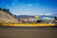 OTAVALO, ECUADOR, SEPTEMBER 03, 2017: View of some cars traveling around the arena in a beautiful day, in a rural road. On the outskirts of Otavalo Royalty Free Stock Photo