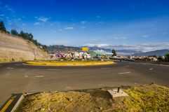 OTAVALO, ECUADOR, SEPTEMBER 03, 2017: View of some cars traveling around the arena in a beautiful day, in a rural road. On the outskirts of Otavalo royalty free stock photography