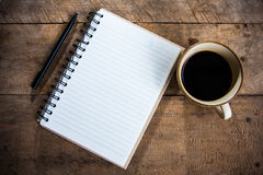 Otebook pen and cup of coffee Stock Images