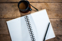 Otebook pen and cup of coffee Stock Image