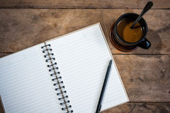 Otebook pen and cup of coffee royalty free stock photography