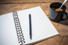Otebook pen and cup of coffee Royalty Free Stock Photo
