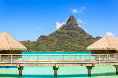 Otemanu mountain view and traditional overwater bungalow's wit Stock Photography