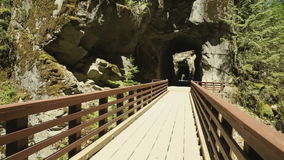 Othello Railroad Tunnels, British Columbia. A steadicam shot along a bridge leading into the Othello Tunnels in Coquihalla Canyon Provincial Park near Hope stock video