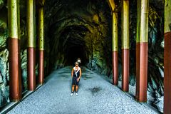 Othello Tunnels at the Coquihalla Canyon and the now abandoned Kettle Valley Railway. Woman walking into the Othello Tunnels that were carved through the royalty free stock photos