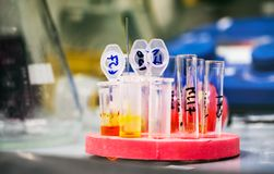 Eppendorf tubes in stand filled with chemical. Other chemical equpments in the background stock image