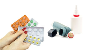 Other drugs to treat asthma and pills in hand Stock Photography