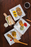 Other fish dishes. Taken from above on a wooden table royalty free stock image