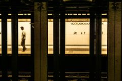 Other side if the Tracks. Subway in NYC Lone figure on other side of the tracks royalty free stock photo
