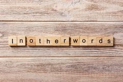 In other words word written on wood block. in other words text on table, concept.  royalty free stock image