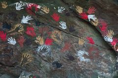 Hand prints. Coloured hand prints on rock royalty free stock photo