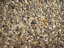 Otoczak betonowej ściany tekstury kamienny tło obrazy royalty free