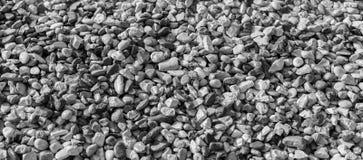 Otoczaka Plażowy tło czarny white obrazy stock