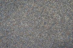 Otoczaki drylują drogowego tekstury tło fotografia stock