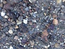 Otoczaki różni rozmiary i kolory na bruku Zdjęcie Royalty Free