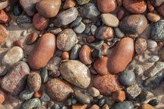Otoczaki w piasku Zdjęcia Royalty Free