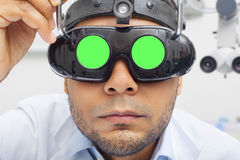 Otolaryngologist  Doctor Looking Through Magnifying Loupe mockup Royalty Free Stock Photos