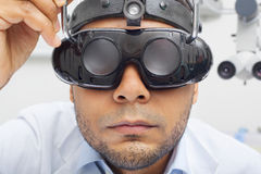 Otolaryngologist  Doctor Looking Through Magnifying Loupe mockup Stock Images