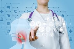 Otolaryngologist is operating with medical treatment structure royalty free stock image