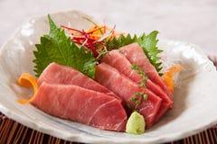 Otoro (Fat Tuna Belly) Sashimi. Thin slices of fat tuna belly sashimi on a plate Stock Photos