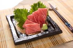 Otoro (Fat Tuna Belly) Sashimi. Thin slices of fat tuna belly sashimi on a stone plate Stock Photos