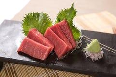 Otoro (Fat Tuna Belly) Sashimi. Thin slices of fat tuna belly sashimi on a stone plate Stock Photography