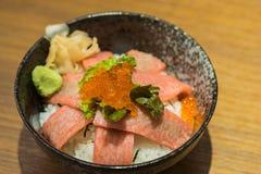 Otoro sashimi (raw tuna with fat) and salmon eggs on top of Japanese rice Royalty Free Stock Photos