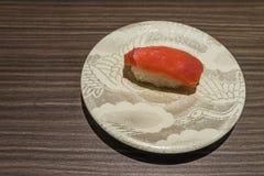 Otoro Tuna sushi, Japanese food white dish on wooden table Stock Photos
