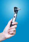 Otoscope in hand. Hand hold Otoscope,Otoscope in hand Royalty Free Stock Image