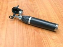Otoscope on wood floor stock images