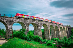 Railway bridge and train Stock Photography