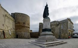 Medieval castle and monument erected for heroes of 1480 in Otranto, Italy. Apulia. OTRANTO, APULIA ,ITALY - MARCH 30, 2018: Medieval castle and monument erected royalty free stock photo