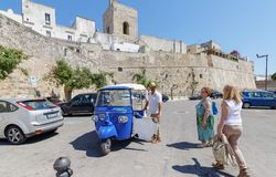 Three wheeler taxi in Otranto Italy. Otranto is a coastal town in southern Italy's Apulia region. It's home to the 15th-century Aragonese Castle and 11th Royalty Free Stock Photos