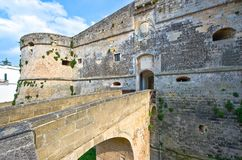 The art and the sea of Otranto. Otranto, Italy - April 11, 2010: View of the main  entrance  bridge and door of the Aragonese castle Royalty Free Stock Image