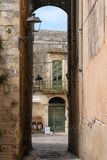 Building with green shutters on a street in the coastal town of Otranto on the Salento peninsula, Puglia, South Italy. Otranto, Italy. Building with green stock photos