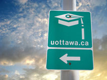 Ottawa. Ontario university green sign with clouds Stock Photos