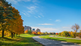Ottawa along the riverside parkway - winding paved roads make for an outing in autumn afternoon sun. Traffic along Ottawa riverside parkway - runners on winding Stock Images