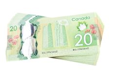 Ottawa, Canada, Avril 13, 2013,  The New Polymer Twenty Dollar Bills isolated on white. A stack of new polymer Canadian twenty dollar bills, isolated on white Royalty Free Stock Image