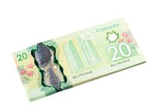 Ottawa, Canada, Avril 13, 2013,  The New Polymer Twenty Dollar Bills isolated on white Royalty Free Stock Images